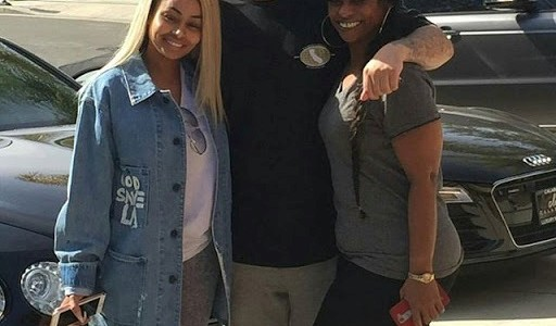 Blac Chyna and her Mum poses with Robert Kardashian