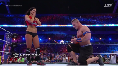 WWE Legend, John Cena Proposes to girlfriend in front of fans at Wrestling Mania Ring